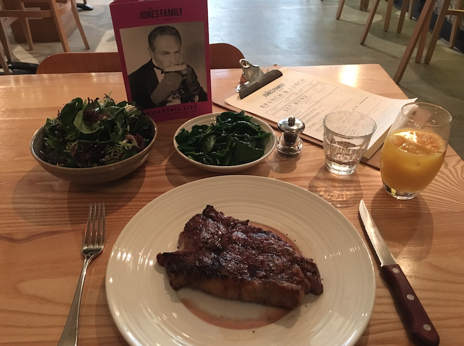 Image by TravelVince – Sirloin steak with tossed spinach and green leaves