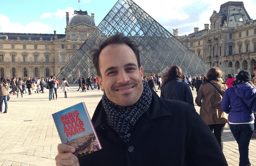 Hello from Paris. This is me a few years ago with a printed copy of my Paris guidebook