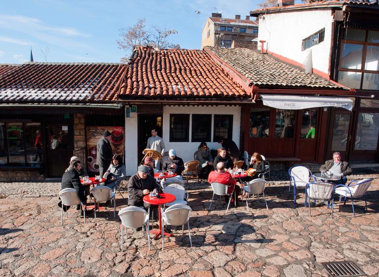 Coffee drinkers along Bascarsija in Sarajevo by Radiokafka / Shutterstock